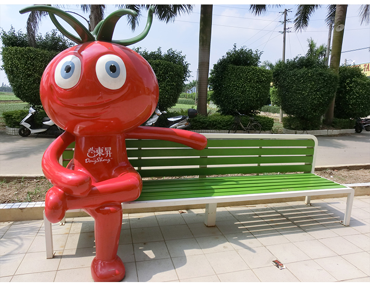 木质不锈钢景观长条坐凳西红柿玻璃钢雕塑结合